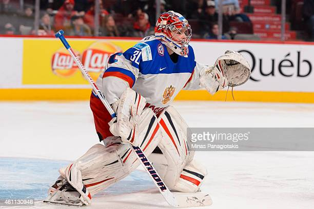 Igor Shesterkin of Team Russia looks towards the play in a quarterfinal round during the 2015 IIHF World Junior Hockey Championships against Team...