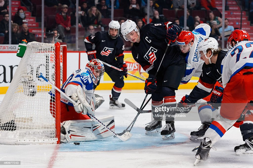 Igor Shesterkin #30 of Team Russia makes a pad save in front of Jack Eichel #9 of Team United States in a quarterfinal round during the 2015 IIHF World Junior Hockey Championships at the Bell Centre on January 2, 2015 in Montreal, Quebec, Canada. Team Russia defeated Team United States 3-2.