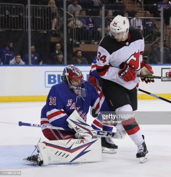 Igor Shesterkin of the New York Rangers defends the net against Brandon Baddock of the New Jersey Devils during the third period at Madison Square...