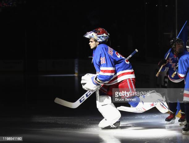 Igor Shesterkin of the New York Rangers leads the team out to play against the New Jersey Devils at Madison Square Garden on January 09 2020 in New...