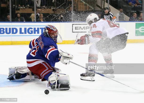 Igor Shesterkin of the New York Rangers makes the third period save on Miles Wood of the New Jersey Devils at Madison Square Garden on September 18...