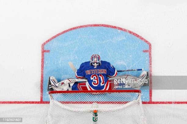 Igor Shesterkin of the New York Rangers stretches during the game against the Colorado Avalanche at Madison Square Garden on January 07 2019 in New...