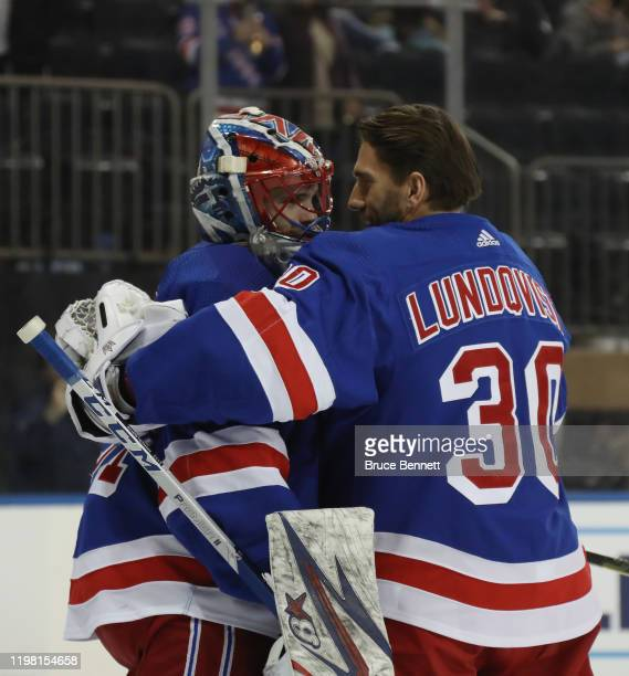 Igor Shesterkin of the New York Rangers who was playing in his first NHL game records a 53 victory over the Colorado Avalanche and is embraced by...