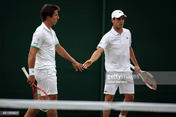 Igor Sijsling of Netherlands and Roberto Bautista Agut of Spain during their Gentlemen's Doubles first round match against Sergiy Stakhovsky of...