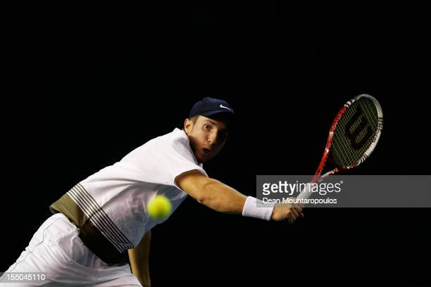 Igor Sijsling of Netherlands in action against Janko Tipsarevic of Serbia during day 3 of the BNP Paribas Masters at Palais Omnisports de Bercy on...