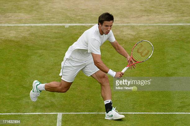 Igor Sijsling of Netherlands plays a backhand during his Gentlemen's Singles second round match against Milos Raonic of Canada on day four of the...