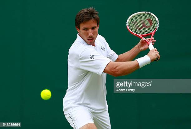Igor Sijsling of Netherlands plays a backhand during the Men's Singles first round match against Jiri Vesely of Czech Republic on day three of the...
