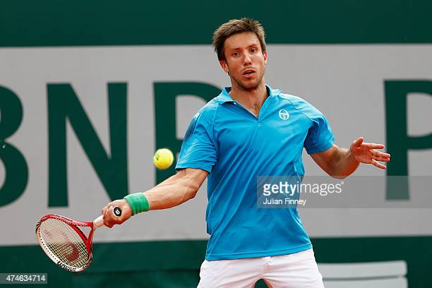 Igor Sijsling of Netherlands plays a forehand in his Men's Singles match against Ernests Gulbis of Latvia on day one of the 2015 French Open at...
