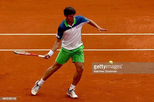 Igor Sijsling of Netherlands returns a shot during his men's singles match against David Ferrer of Spain on day three of the French Open at Roland...
