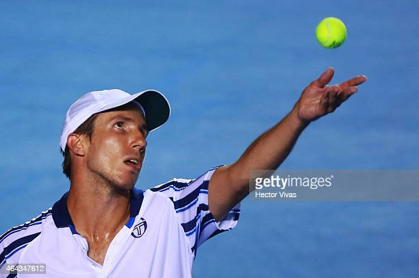 Igor Sijsling of Netherlands serves a shot against David Ferrer of Spain during a men's singles match as part of Telcel Mexican Open 2015 at Mextenis...