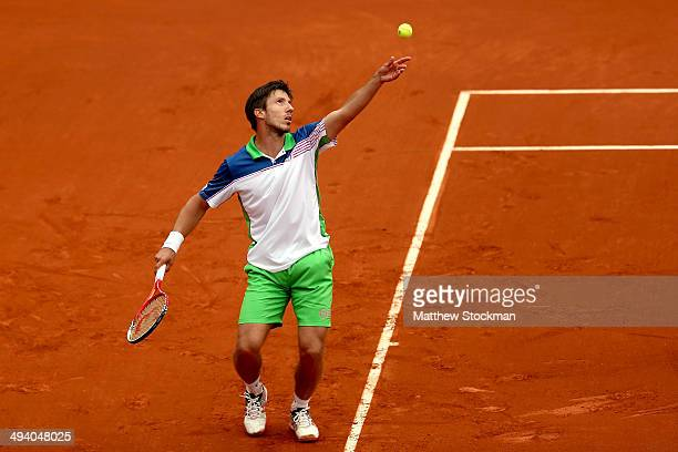 Igor Sijsling of Netherlands serves during his men's singles match against David Ferrer of Spain on day three of the French Open at Roland Garros on...