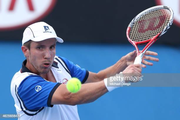 Igor Sijsling of the Netherlands plays a backhand in his first round match against Thanasi Kokkinakis of Australia during day two of the 2014...