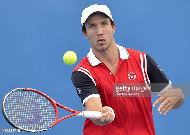 Igor Sijsling of the Netherlands plays a backhand in his match partnered with Denis Istomin of Uzbekistan in their match against Mariusz Fyrstenberg...
