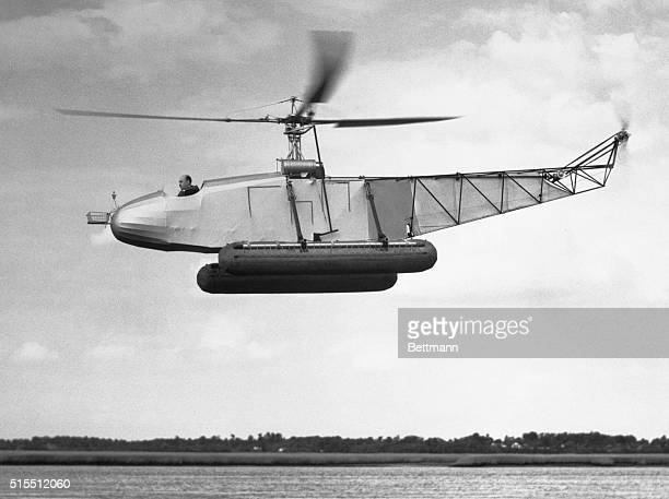 Igor Sikorsky's helicopter model VS300 equipped with pontoons Photo shows helicopter in action flying over water