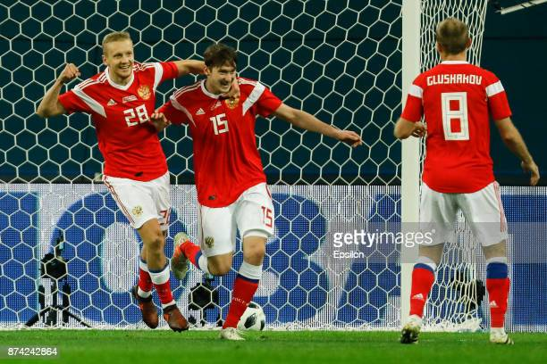 Igor Smolnikov Aleksei Miranchuk and Denis Glushakov of Russia celebrate a goal during Russia and Spain International friendly match on November 14...