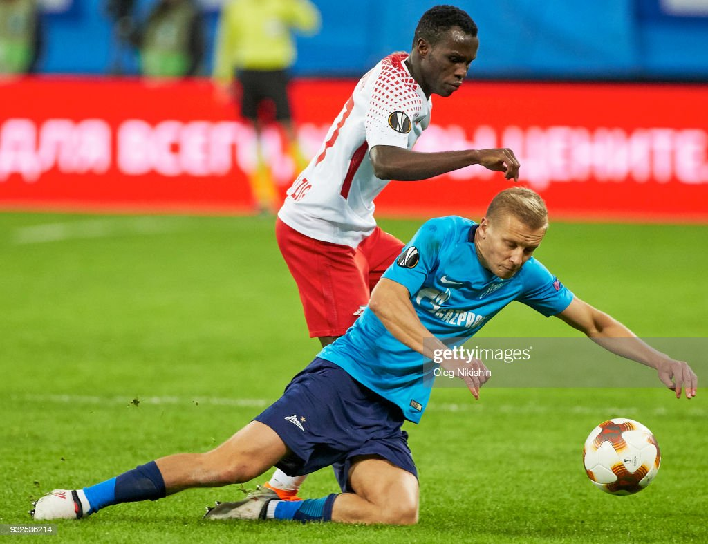 Igor Smolnikov of FC Zenit vies for the ball with Bruma of RB Leipzig during UEFA Europa League Round of 16 match between Zenit St Petersburg and RB Leipzig at the on March 15, 2018 in Saint Petersburg, Russia.