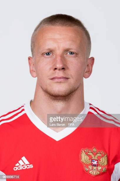 Igor Smolnikov of Russia poses for a portrait during the official FIFA World Cup 2018 portrait session at Federal Sports Centre Novogorsk on June 8...