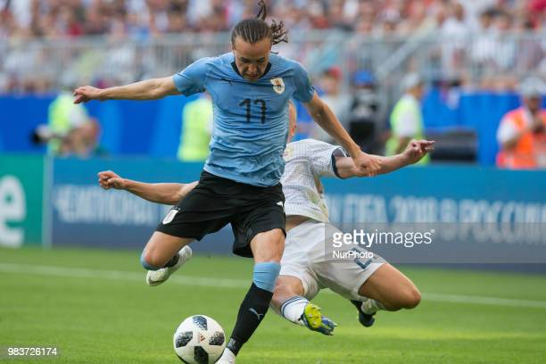 Igor Smolnikov of Russia vies Diego Laxalt of Uruguay during the 2018 FIFA World Cup Russia group A match between Uruguay and Russia at Samara Arena...
