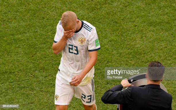 Igor Smolnikov of Russia walks off the pitch dejected after being sent off during the 2018 FIFA World Cup Russia group A match between Uruguay and...