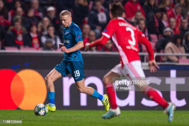 Igor Smolnikov of Zenit St Petersburg and Alex Grimaldo of SL Benfica battle for the ball during the UEFA Champions League group G match between SL...