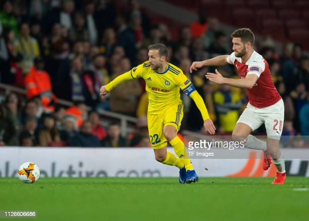 Igor Stasevich of BATE Borisov and Shkodran Mustafi of Arsenal battle for the ball during the UEFA Europa League Round of 32 Second Leg match between...
