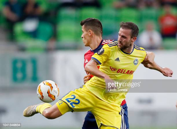 Igor Stasevich of FC BATE Borsiov competes for the ball with Zsombor Berecz of Vidi FC during the UEFA Europa League Group Stage match between Vidi...
