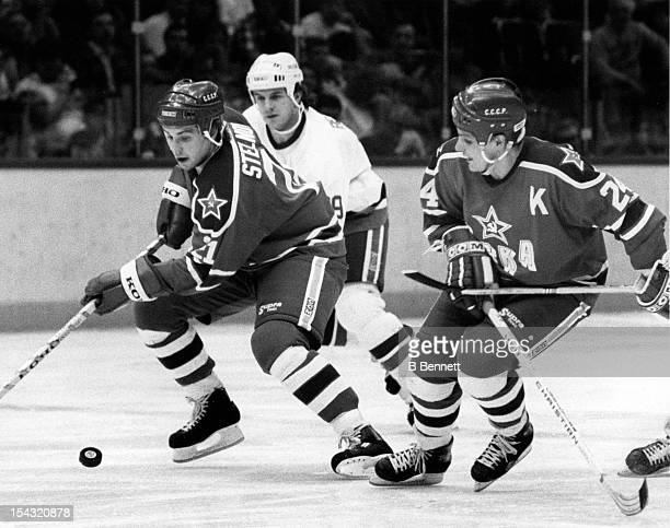 Igor Stelnov and Sergei Makarov of CSKA Moscow skate with the puck during their game against the New York Islanders on December 29, 1988 at the...