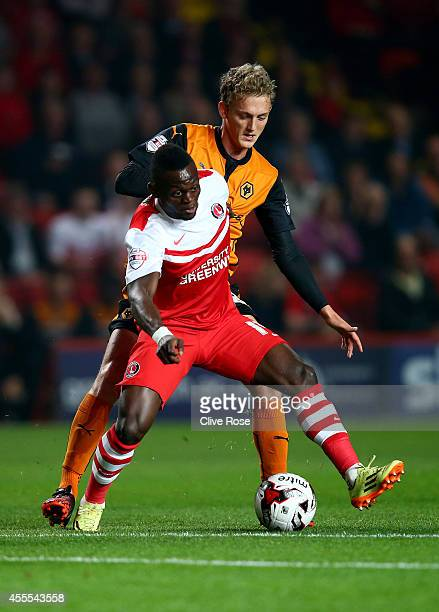 Igor Vetokele of Charlton Athletic is challenged by George Saville of Wolverhampton Wanderers during the Sky Bet Championship match between Charlton...