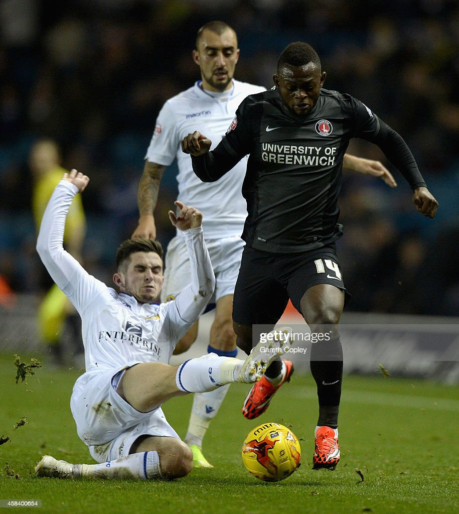 Igor Vetokele of Charlton Athletic is tackled by Lewis Cook of Leeds United during the Sky Bet Championship match between Leeds United and Charlton Athletic at Elland Road on November 4, 2014 in Leeds, England.