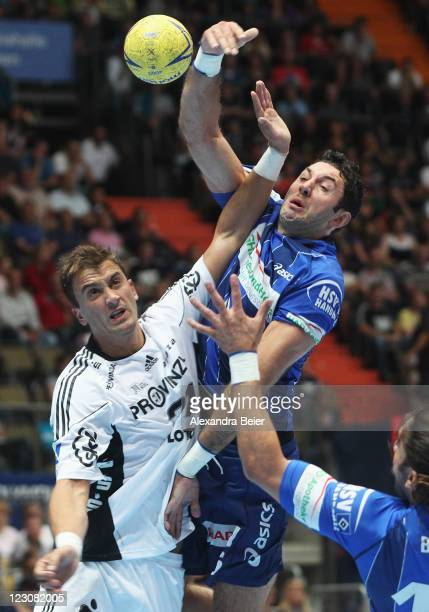 Igor Vori of Hamburg is challenged by Momir Ilic of Kiel during the Handball Supercup match between HSV Hamburg and THW Kiel on August 30 2011 in...