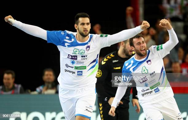 Igor Zabic and Matic Verdinek of Slovenia celebrate during the Men's Handball European Championship Group C match between Montenegro and Slovenia at...