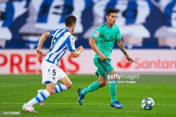 Igor Zubeldia of Real Sociedad competes for the ball with James Rodriguez of Real Madrid during the La Liga match between Real Sociedad and Real...