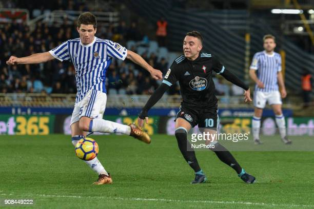 Igor Zubeldia of Real Sociedad duels for the ball with Iago Aspas of Celta during the Spanish league football match between Real Sociedad and Celta...