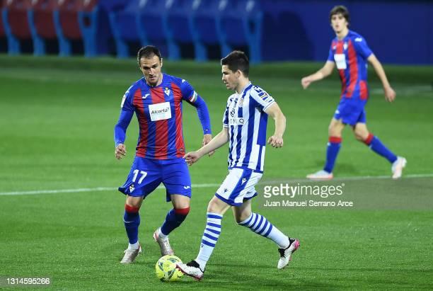 Igor Zubeldia of Real Sociedad is put under pressure by Kike of SD Eibar during the La Liga Santander match between SD Eibar and Real Sociedad at...