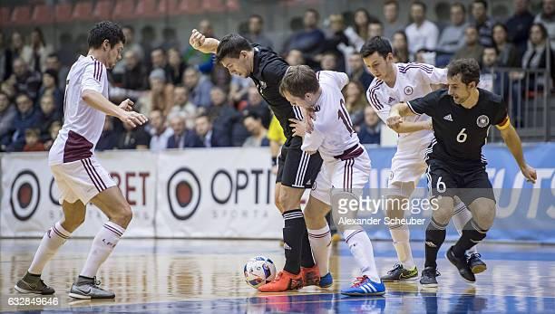 Igors Lapkovskis of Latvia challenges Marc Philipp Nebgen of Germany during the UEFA Futsal European Championship Qualifying match between Latvia and...