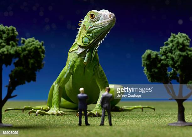 Iguana confronting toy businessmen