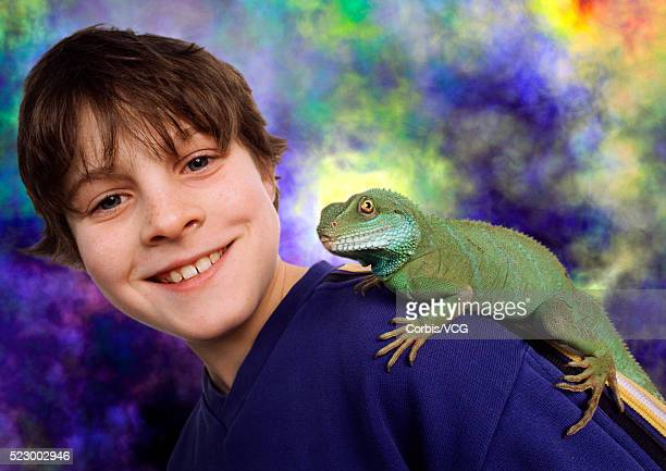 Iguana Resting on Boy's Shoulder
