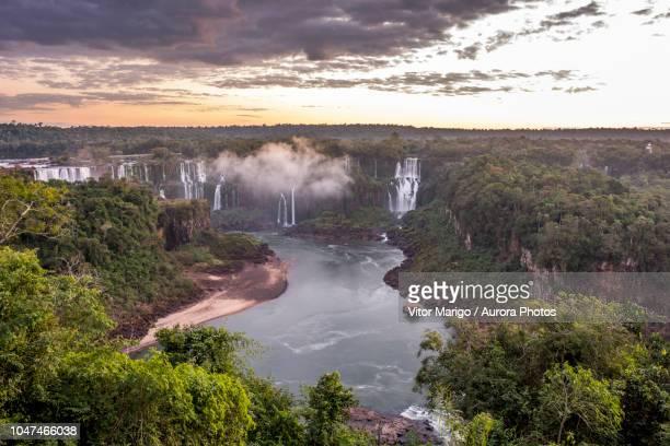 iguazu falls at dusk, parana, brazil - イグアス滝 ストックフォトと画像