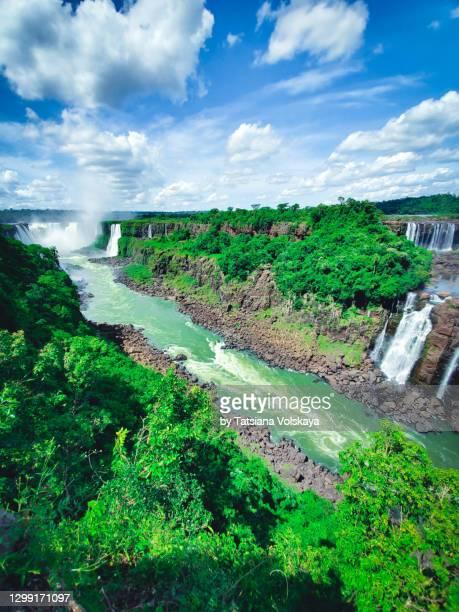 iguazu falls bright panoramic background - フォスドイグアス ストックフォトと画像