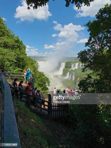 Iguazu Falls (Cataratas do Iguaçu, Brazil) observation platform with tourists