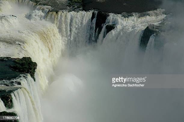 Iguazu Falls, on the border of Argentina and Brazil, on average flow at a rate of 1750 cubic metres of water per second.