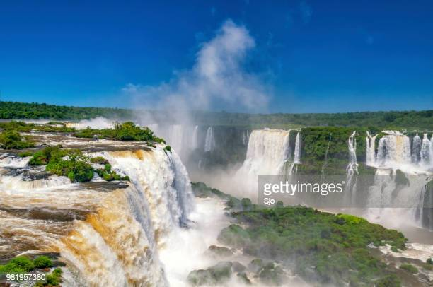 iguazu falls on the border of argentinia and brazil in south america - parana state stock pictures, royalty-free photos & images