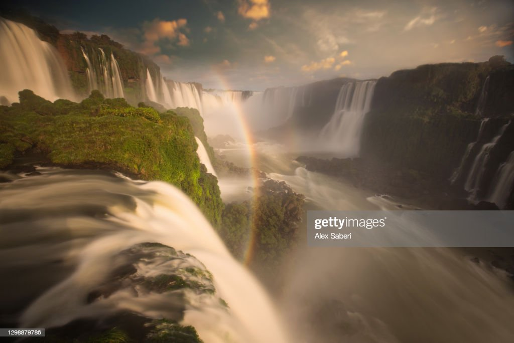 Iguazu falls waterfalls at sunset. : Stock Photo