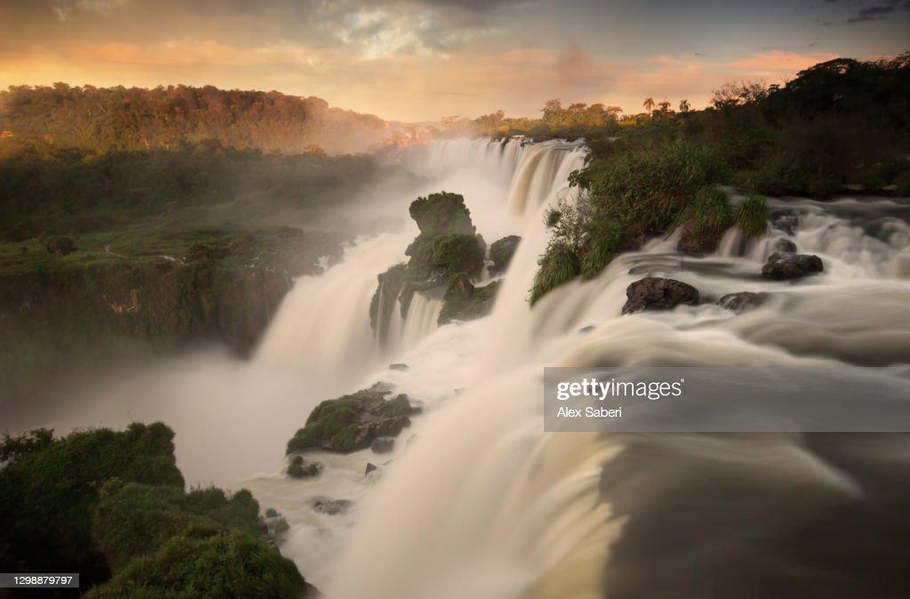 Iguazu falls waterfalls at sunset. : Stock Photo