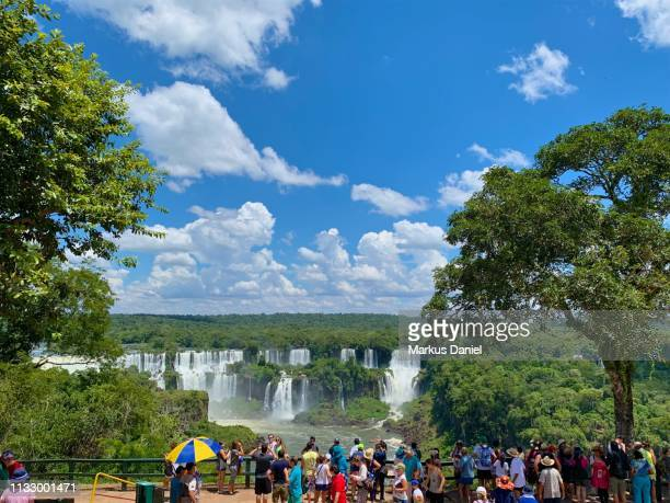 Iguazu Falls (Cataratas do Iguaçu, Brazil) with tourist at observation area