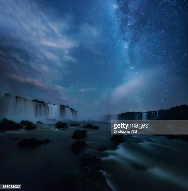 Iguazu waterfalls in brazil with the stars and milky way at night