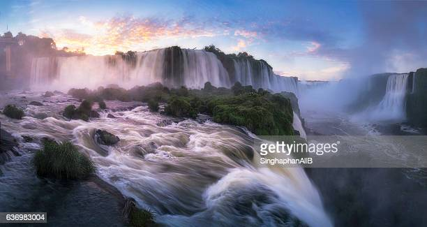 iguazu waterfalls in the morning sunrise - brazil vs argentina stock photos and pictures