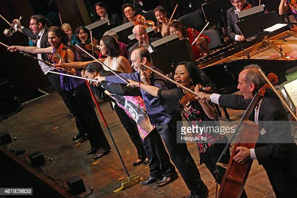 Igudesman Joo performing with the New York Philharmonic led by Alan Gilbert at Avery Fisher Hall on Tuesday night December 31 2013This imageHyungki...