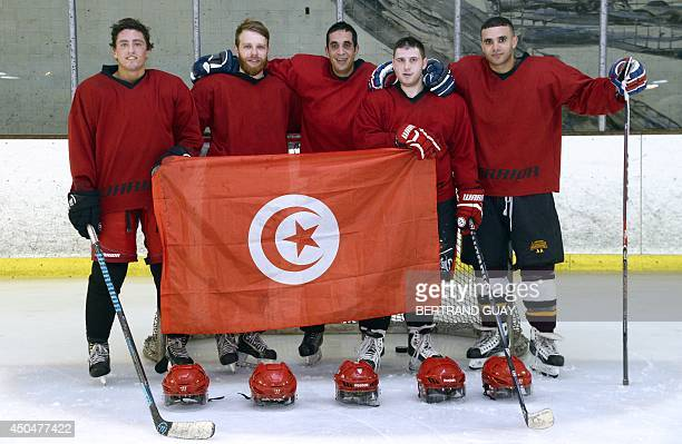 Ihab Ayed President of the Tunisian Ice Hockey Association poses with members of the Tunisian national hockey team during a training session at an...