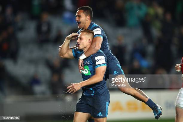 Ihaia West of the Blues celebrates his try with Sam Nock during the match between the Auckland Blues and the British Irish Lions at Eden Park on June...